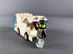 Driver closing van boot