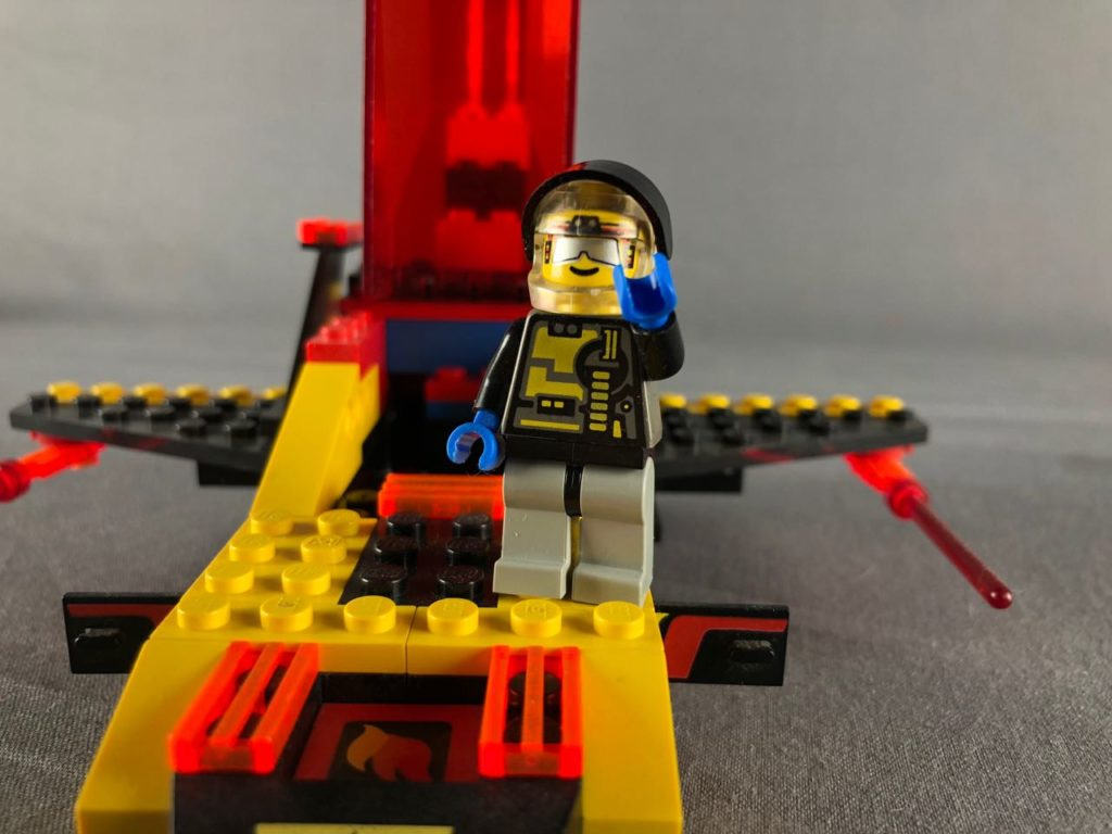 Minifigure posing with spaceship
