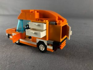 side view of tangerine truck with drawers and doors open