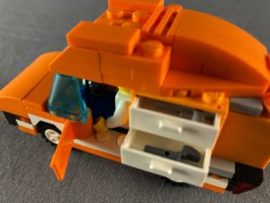 close up of tangerine truck from top with drawers open