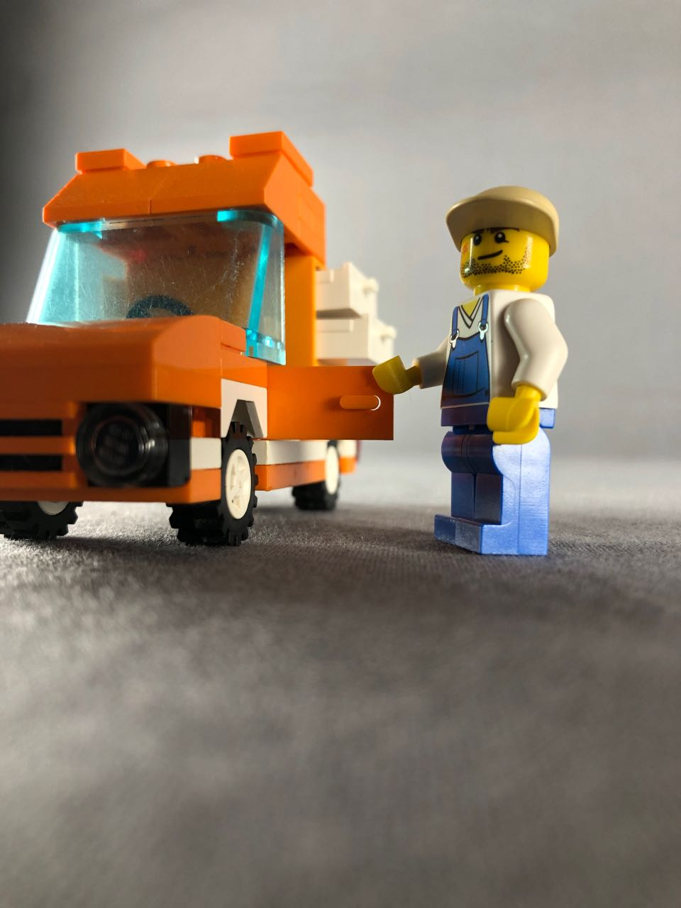 front of tangerine truck with closeup of mini figure